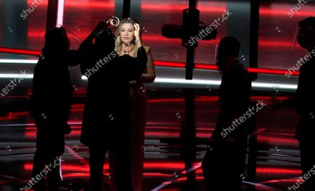 Host Kelly Clarkson has her make-up retouched before the start of the Billboard Music Awards, at the Dolby Theatre in Los Angeles