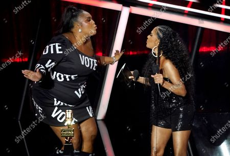 Lizzo, left, blows a kiss to presenter Sheila E. as she goes on stage to accept the award for top song sales artist at the Billboard Music Awards, at the Dolby Theatre in Los Angeles