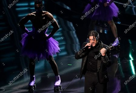 Bad Bunny accepts the award for top Latin artist at the Billboard Music Awards, at the Dolby Theatre in Los Angeles