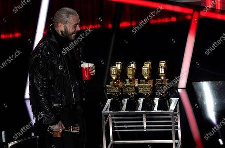 Post Malone appears on stage with his nine awards to include top male artist and top artist at the Billboard Music Awards, at the Dolby Theatre in Los Angeles
