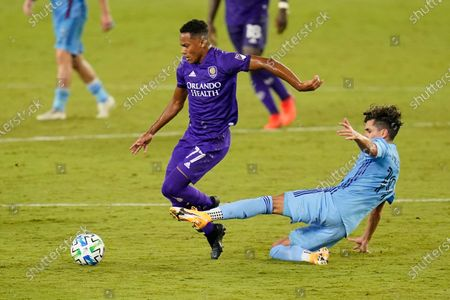 Stock Image of Orlando City forward Robinho (77) moves the ball away from New York City FC forward Jesus Medina during the second half of an MLS soccer match, in Orlando, Fla