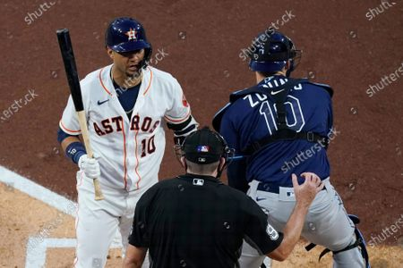 Houston Astros' Yuli Gurriel challenges home plate umpire Chris Conroy on a strike call during the second inning in Game 4 of a baseball American League Championship Series against the Tampa Bay Rays, in San Diego