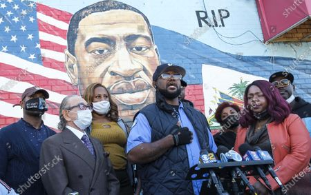 Stock Picture of Terrence Floyd (4-L) stands with community and Black Lives Matter activists in front of a mural of his late brother, George Floyd, during an event organized to mark George's birthday in Brooklyn, New York, USA, 14 October 2020. Floyd was killed on 25 May 2020 while in Minneapolis police custody and his death sparked widespread protests against police brutality.