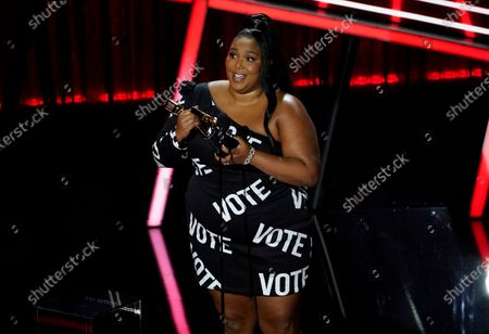 Lizzo accepts the award for top song sales artist at the Billboard Music Awards, at the Dolby Theatre in Los Angeles