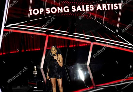 Sheila E. presents the award for top song sales artist at the Billboard Music Awards, at the Dolby Theatre in Los Angeles