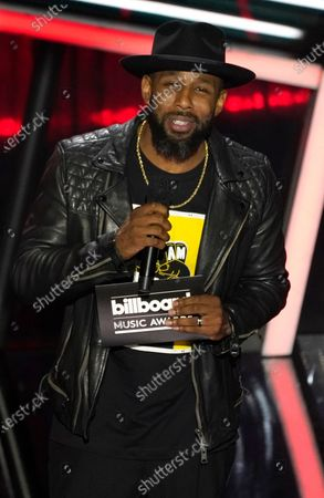 """Stock Photo of Stephen """"tWitch"""" Boss presents the award for top Latin artist at the Billboard Music Awards, at the Dolby Theatre in Los Angeles"""