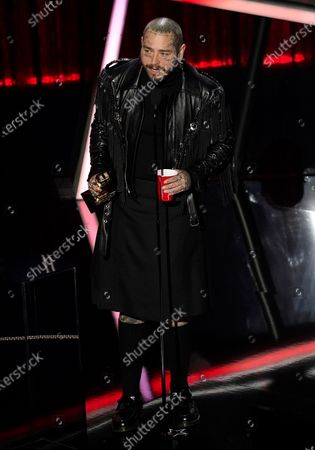 Post Malone accepts the award for top male artist at the Billboard Music Awards, at the Dolby Theatre in Los Angeles