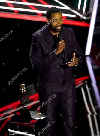 Jay Ellis presents the award for top R&B artist at the Billboard Music Awards, at the Dolby Theatre in Los Angeles