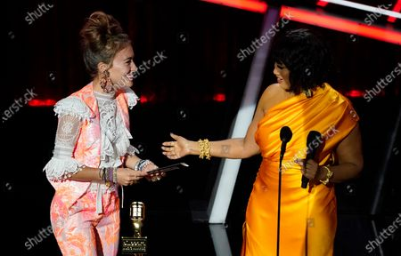 Lauren Daigle, left, accepts the award for top Christian artist from presenter Garcelle Beauvais at the Billboard Music Awards, at the Dolby Theatre in Los Angeles