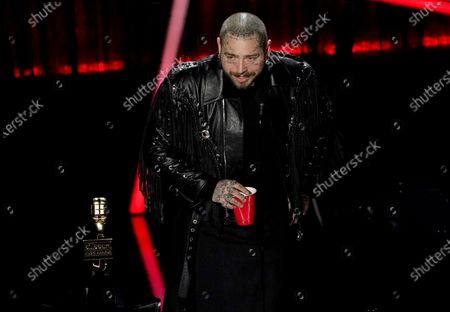 Post Malone accepts the top artist award at the Billboard Music Awards, at the Dolby Theatre in Los Angeles