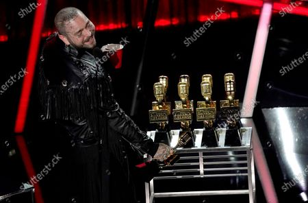 Stock Photo of Post Malone appears on stage with his nine awards to include top male artist and top artist at the Billboard Music Awards, at the Dolby Theatre in Los Angeles