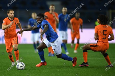 """Stock Photo of Moise Kean (Italy)Nathan Ake (Netherlands)Daley Blind (Netherlands)                       during the Uefa """"Nations League 2020-2021"""" match between Italy 1-1 Neterlands   at Gewiss Stadium in Bergamo, Italy."""