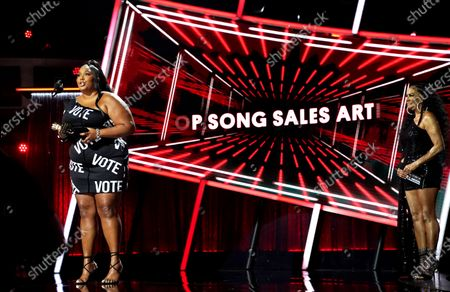 Stock Picture of Lizzo accepts her award for Top Sales Artist during the 2020 Billboard Music Awards held at the Dolby Theatre in Hollywood, CA. (Andrew Gombert / Los Angeles Times)