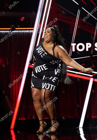 Stock Image of Lizzo accepts her award for Top Song Sales Artist during the 2020 Billboard Music Awards held at the Dolby Theatre in Hollywood, CA. (Andrew Gombert / Los Angeles Times)