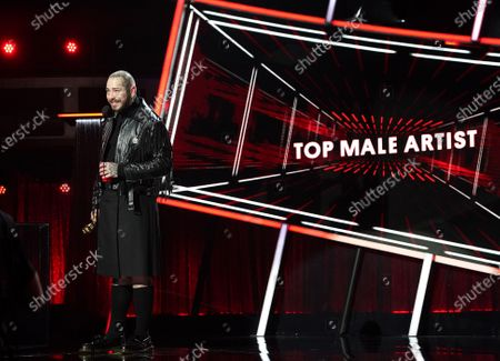 Stock Image of Post Malone accepts Top Male Artist award during the 2020 Billboard Music Awards held at the Dolby Theatre in Hollywood, CA. (Andrew Gombert / Los Angeles Times)