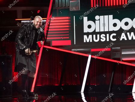 Post Malone accepts the Top Artist award during the 2020 Billboard Music Awards held at the Dolby Theatre in Hollywood, CA. (Andrew Gombert / Los Angeles Times)