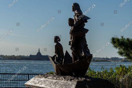 "Stock Image of View of the statue of Mother Cabrini in Battery Park City, New York City. A year after a tribute to Mother Cabrini was skipped by City Hall's much vaunted ""She Built NYC"" commission, Governor Andrew Cuomo gave America's first saint the respect she deserved with the unveiling of the new statue in Battery Park City for Columbus Day. Normally, Cuomo would be leading the Columbus Day Parade up Fifth Avenue, but COVID-19 resulted in the cancellation of most every major parade in the city. The governor told members of the Columbus Citizens Foundation that he would unveil the statue to mark the Columbus Day celebration."