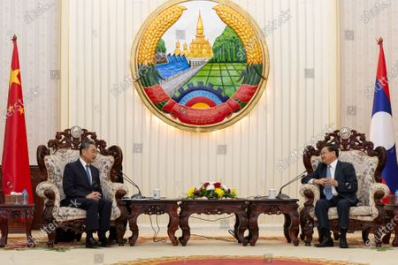 Lao Prime Minister Thongloun Sisoulith meets with Chinese State Councilor and Foreign Minister Wang Yi in Vientiane, Laos, Oct. 14, 2020.