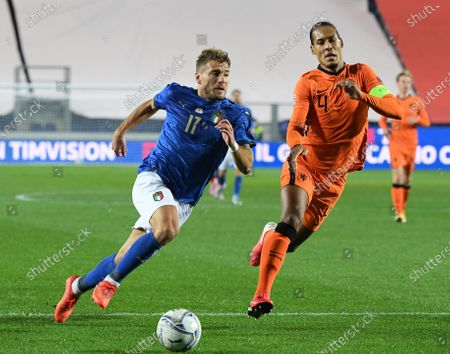 Italy's Ciro Immobile (L) breaks through past Netherlands' Virgil van Dijk during their UEFA Nations League football match in Bergamo, Italy, Oct. 14, 2020.