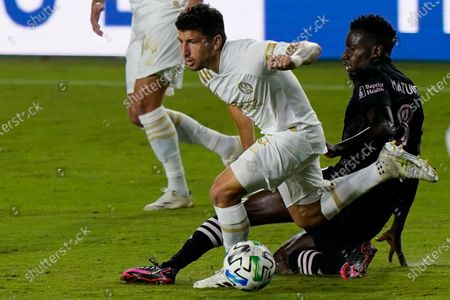 Stock Image of Atlanta United midfielder Eric Remedi, left, and Inter Miami midfielder Blaise Matuidi battle for the ball during the first half of an MLS soccer match, in Fort Lauderdale, Fla