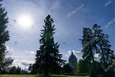 The Washington state Capitol is shown under clear skies, in Olympia, Wash., in contrast to several weeks earlier when the area was choked with smoke. Wildfires churning out dense plumes of smoke as they scorch huge swaths of the U.S. West Coast have exposed millions of people to hazardous pollution levels, causing emergency room visits to spike and potentially thousands of deaths among the elderly and infirm, according to an Associated Press analysis of pollution data and interviews with physicians, health authorities and researchers