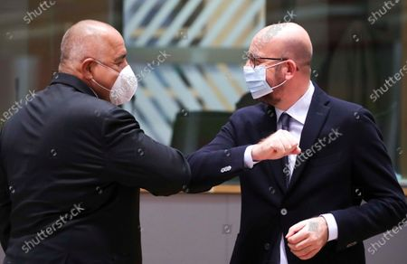 European Council President Charles Michel, right, greets Bulgaria's Prime Minister Boyko Borissov with an elbow bump during a round table meeting at an EU summit at the European Council building in Brussels, . European Union leaders are meeting in person for a two-day summit amid the worsening coronavirus pandemic to discuss topics ranging from Brexit to climate and relations with Africa