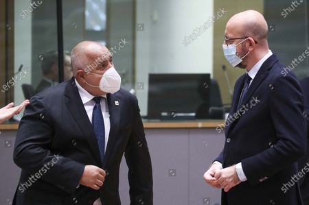 European Council President Charles Michel, right, speaks with Bulgaria's Prime Minister Boyko Borissov during a round table meeting at an EU summit at the European Council building in Brussels, . European Union leaders are meeting in person for a two-day summit amid the worsening coronavirus pandemic to discuss topics ranging from Brexit to climate and relations with Africa