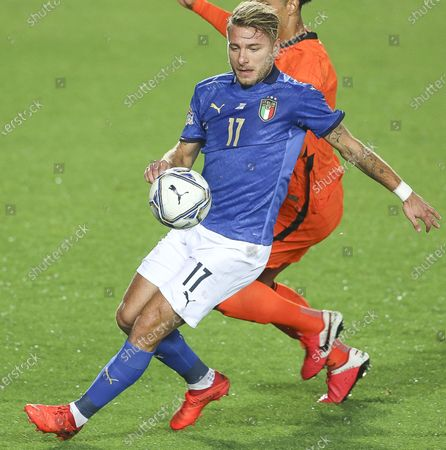 Italy's Ciro Immobile, Netherlands' V.van Dijk during the match