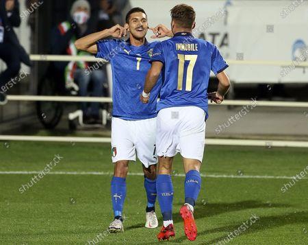 Italy's Lorenzo Pellegrini celebrates after the goal with Ciro Immobile