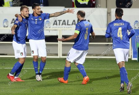 Italy's Lorenzo Pellegrini celebrates after the goal with Ciro Immobile, Chiellini and Spinazzola