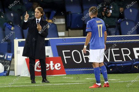 Italy's coach Roberto Mancini and Italy's Ciro Immobile during the match