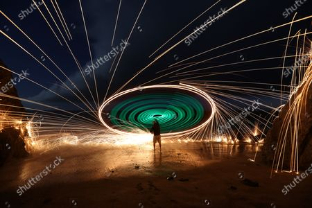 A spinning disc creates an extraordinary umbrella of sparks which illuminate the night sky.  This incredible effect is the result of lighting steel wire wool attached to a nylon 'trick line' and spinning it in circles.  The long exposure shots were taken over three second periods at Sunset Cliffs Natural Park, in San Diego, USA, by hotel worker Chris Brady, who has been practising steel wool photography for over five years.