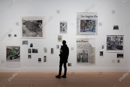 Stock Picture of A man looks at the artwork 'Soldiers - The Nineties' by Wolfgang Tillmans during a press preview of the exhibition 'Masculinities: Liberation Through Photography' at the Gropius Bau in Berlin, Germany, 15 October 2020. The exhibition runs from 16 October 2020 to 10 January 2021.