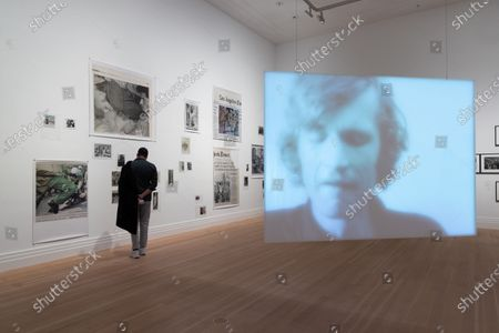 A man looks at the artwork 'Soldiers - The Nineties' by Wolfgang Tillmans during a press preview of the exhibition 'Masculinities: Liberation Through Photography' at the Gropius Bau in Berlin, Germany, 15 October 2020. The exhibition runs from 16 October 2020 to 10 January 2021.