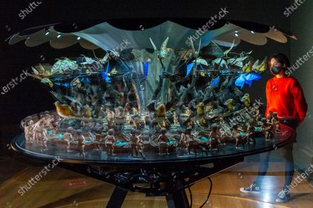 Stock Image of Artwork titled The Garden of Unearthly Delights (2009) by artist Matt Collishaw is displayed as part of the Tate Britain's new collection displays inviting visitors to follow a route inside the venue.