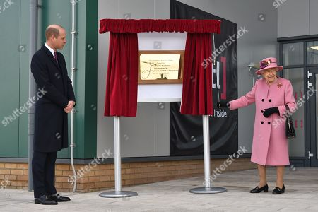 Britain's Prince William, Prince William, (L) stands by as Britain's Queen Elizabeth II (R) unveils a plaque to officially open the new Energetics Analysis Centre at the Defence Science and Technology Laboratory (Dstl) at Porton Down science park near Salisbury, southern England