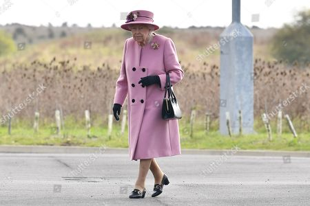 Britain's Queen Elizabeth II arrives at the Energetics Analysis Centre as they visit the Defence Science and Technology Laboratory (Dstl) at Porton Down science park near Salisbury, southern England