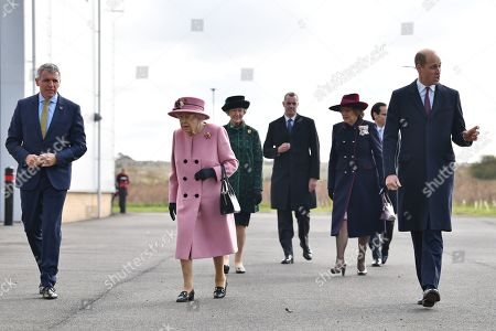 Britain's Queen Elizabeth II (C) and Britain's Prince William, Prince William (R) arrive with Dstl Chief Executive Gary Aitkenhead (L) at the Energetics Analysis Centre as they visit the Defence Science and Technology Laboratory (Dstl) at Porton Down science park near Salisbury, southern England