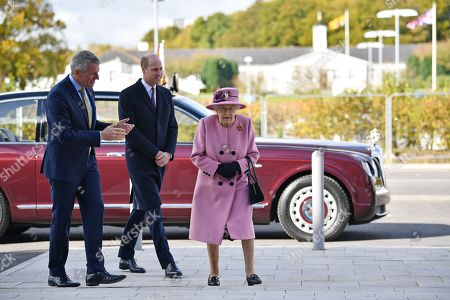 Britain's Queen Elizabeth II (R) and Britain's Prince William, Prince William, (C) speak with Dstl Chief Executive Gary Aitkenhead (L) as they head back to the Energetics Analysis Centre during their visit to the Defence Science and Technology Laboratory (Dstl) at Porton Down science park near Salisbury, southern England