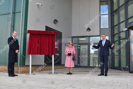 Dstl Chief Executive Gary Aitkenhead (R) speaks as Britain's Queen Elizabeth II (C) and Britain's Prince William, Prince William, (L) prepare to unveil a plaque to officially open the new Energetics Analysis Centre at the Defence Science and Technology Laboratory (Dstl) at Porton Down science park near Salisbury, southern England