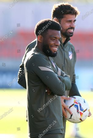 A handout photo made available by Atletico de Madrid shows Atletico Madrid's players Thomas Lemar (front) and Diego Costa attending a team's training session at Wanda Sport Complex, in Majadahonda, Madrid, Spain, 15 October 2020. The team prepares its upcoming LaLiga game against Celta Vigo on 17 October.