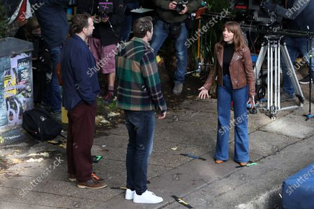 Stock Photo of Rafe Spall, Ophelia Lovibond and Oliver Chris filming for Apple TV show 'Trying'.
