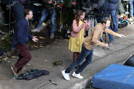 Stock Picture of Rafe Spall, Esther Smith and Oliver Chris filming for Apple TV show 'Trying'.