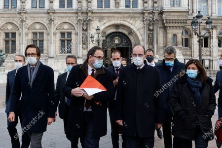 Stock Image of (L-R) La Republique en Marche (LREM) deputy Pacome Rupin, Head of Ile-de-France Regional Health Agency (ARS) Aurelien Rousseau, French Prime Minister Jean Castex and Mayor of Paris Anne Hidalgo walk towards AP-HP (Assistance Publique - Hopitaux de Paris) headquarters in Paris, 15 October 2020. France on October 14 became the latest European country to toughen anti-coronavirus measures, imposing a curfew in Paris and eight other cities from October 17.