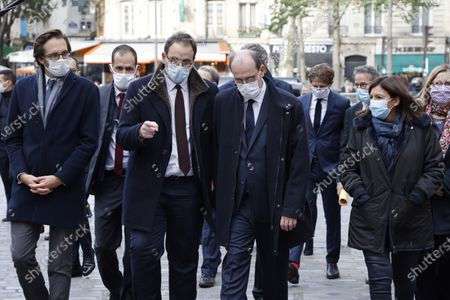 (L-R) La Republique en Marche (LREM) deputy Pacome Rupin, Head of Ile-de-France Regional Health Agency (ARS) Aurelien Rousseau, French Prime Minister Jean Castex and Mayor of Paris Anne Hidalgo walk towards Paris City Hall after visiting a COVID-19 test centre in Paris, 15 October 2020. France on October 14 became the latest European country to toughen anti-coronavirus measures, imposing a curfew in Paris and eight other cities from October 17.