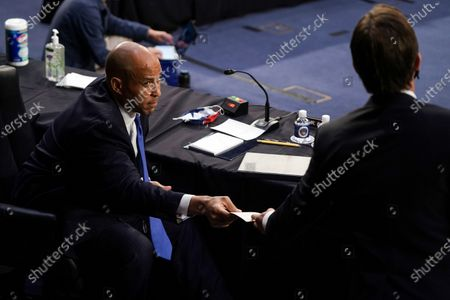 Sen. Cory Booker (D-N.J.) receives a note from Sen. Ben Sasse (R-Neb.) during a Senate Judiciary Committee business meeting prior to the fourth day of Senate Judiciary Committee confirmation hearings for Judge Barrett on Capitol Hill in Washington, DC, USA, 15 October 2020. The hearings are expected to last four days.