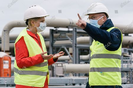Mecklenburg-Western Pomerania State Premier Manuela Schwesig (L) and Mecklenburg-Western Pomerania Minister of Transport Christian Pegel (R) talk in front of a Nord Stream 2 pipeline landfall facility during a visit to the industrial port and the landfall facility of the joint German-Russian pipeline project Nord Stream 2, in Lubmin, Germany, 15 October 2020. The politically controversial pipeline project was put into question in response to the alleged poisoning of Kreml critic Alexei Navalny. Schwesig wants to save the gas pipeline that she regards an important infrastructure project.