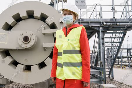 Mecklenburg-Western Pomerania State Premier Manuela Schwesig wears a face mask and a security helmet in front of a pig trap of the Nord Stream 2 pipeline landfall facility during a visit to the industrial port and the landfall facility of the joint German-Russian pipeline project Nord Stream 2, in Lubmin, Germany, 15 October 2020. The politically controversial pipeline project was put into question in response to the alleged poisoning of Kreml critic Alexei Navalny. Schwesig wants to save the gas pipeline that she regards an important infrastructure project.