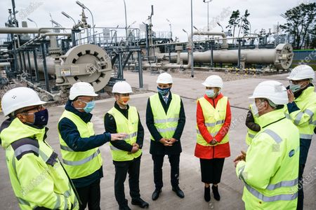 Mecklenburg-Western Pomerania State Premier Manuela Schwesig (red jacket) talks with representatives of the Nord Stream 2 pipeline during a visit to the industrial port and the landfall facility of the joint German-Russian pipeline project Nord Stream 2, in Lubmin, Germany, 15 October 2020. The politically controversial pipeline project was put into question in response to the alleged poisoning of Kreml critic Alexei Navalny. Schwesig wants to save the gas pipeline that she regards an important infrastructure project.