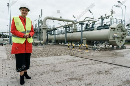 Mecklenburg-Western Pomerania State Premier Manuela Schwesig wears a security helmet while posing in front of a pig trap of the Nord Stream 2 pipeline landfall facility during a visit to the industrial port and the landfall facility of the joint German-Russian pipeline project Nord Stream 2, in Lubmin, Germany, 15 October 2020. The politically controversial pipeline project was put into question in response to the alleged poisoning of Kreml critic Alexei Navalny. Schwesig wants to save the gas pipeline that she regards an important infrastructure project.